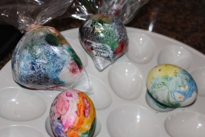 "Mommy & Sidney's crayon eggs in front & food coloring eggs ""curing"" in the back."
